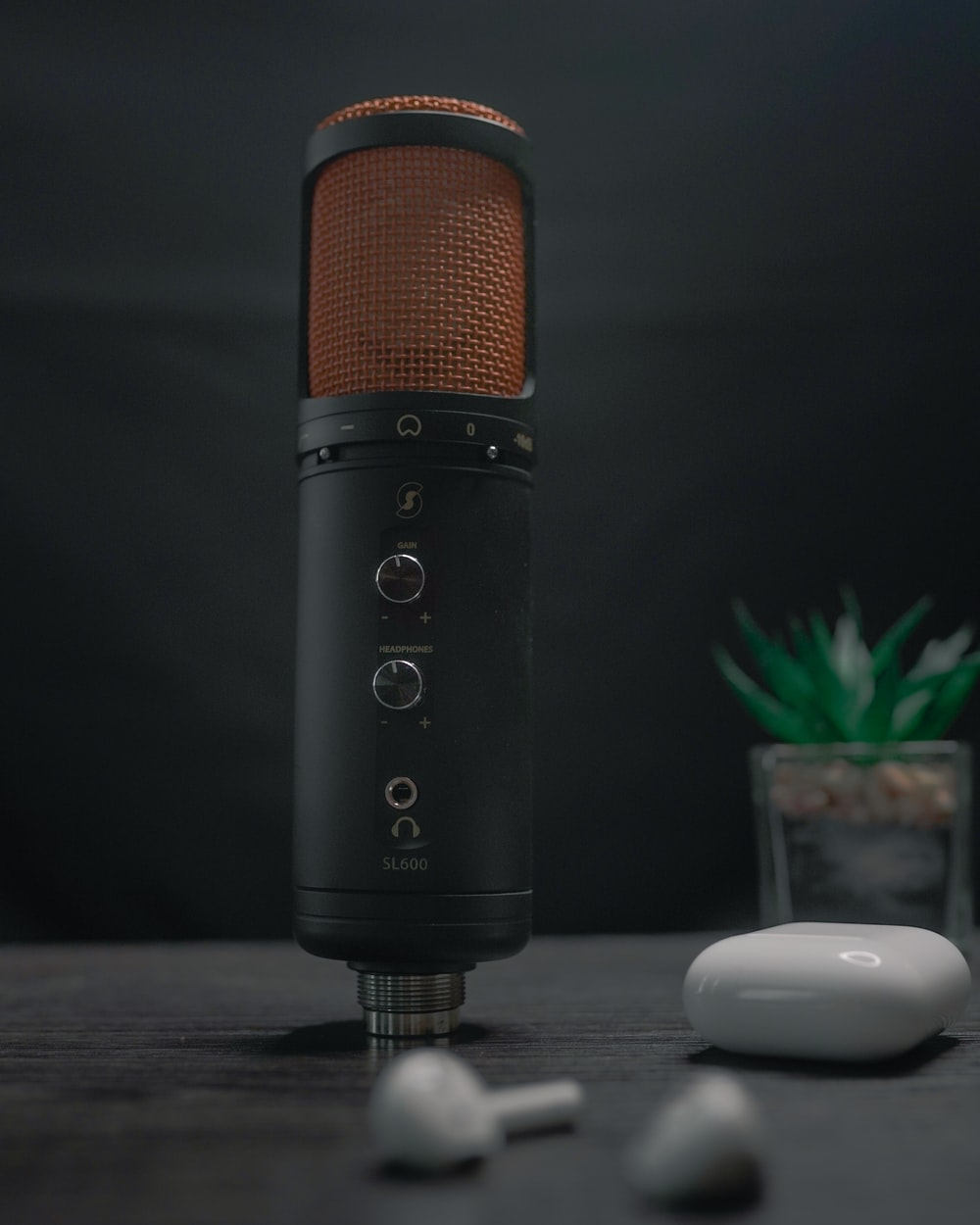 black and orange microphone on table