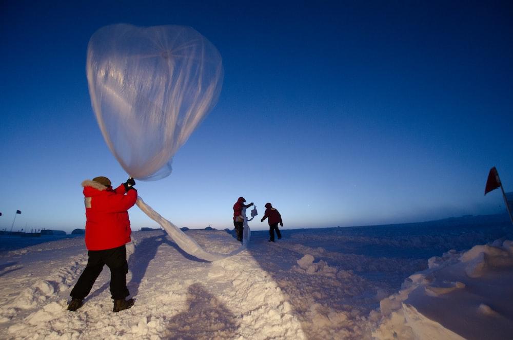Launching an ozonesonde balloon.