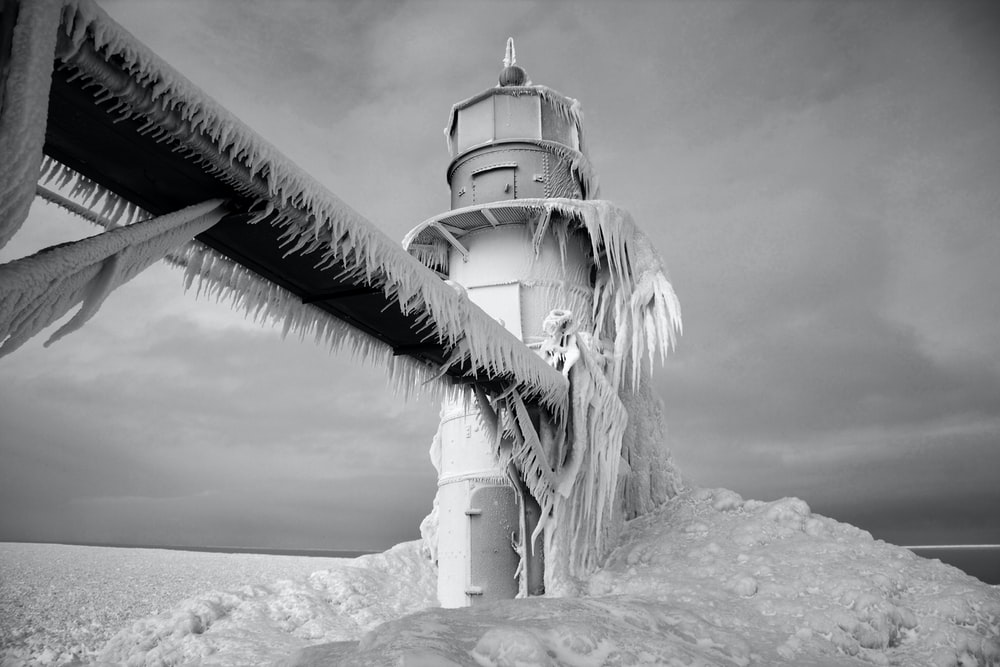 frozen tower under gray sky