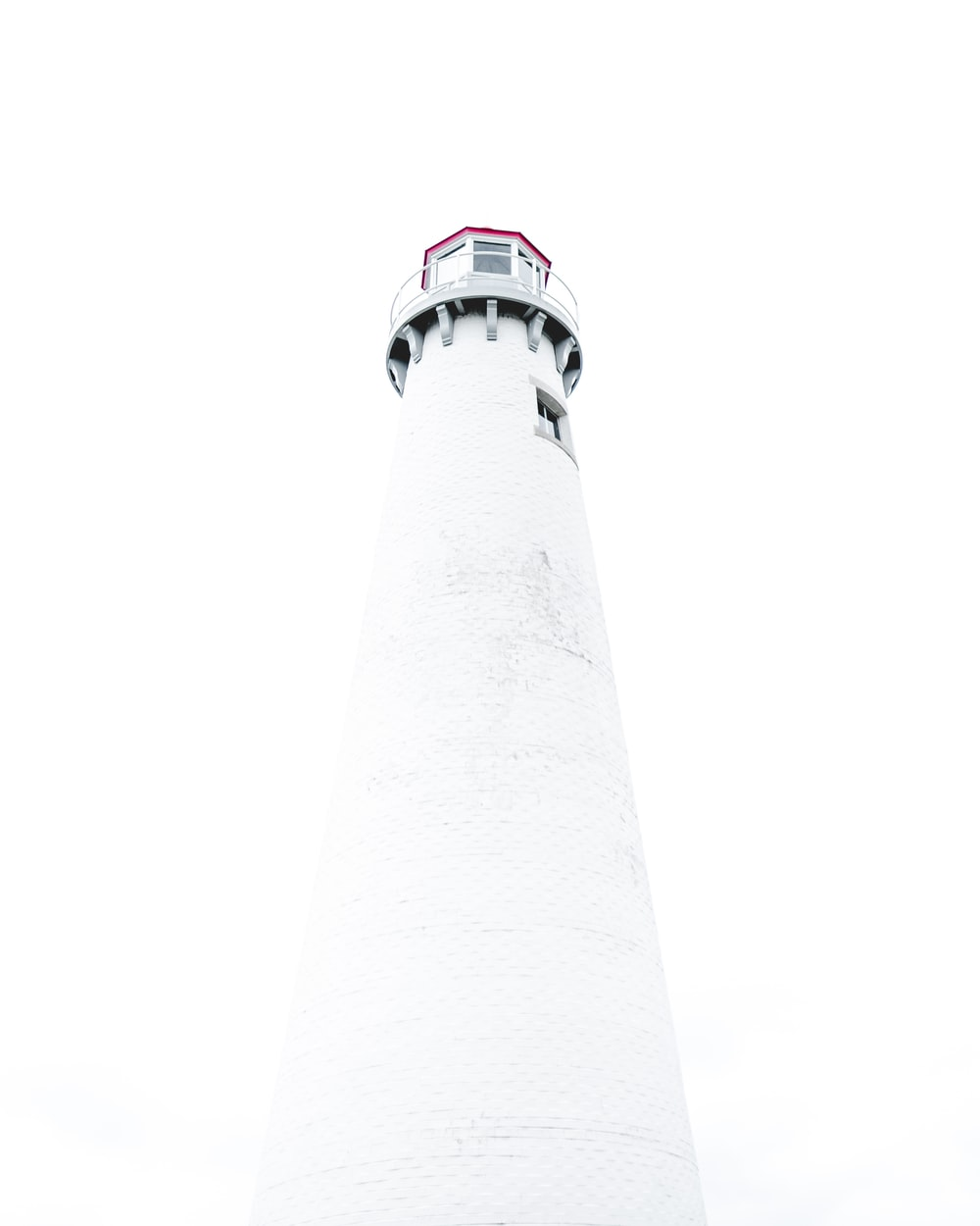 low-angle photography of white light house