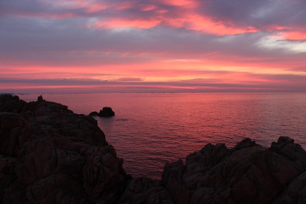 overlooking rock cliff and ocean