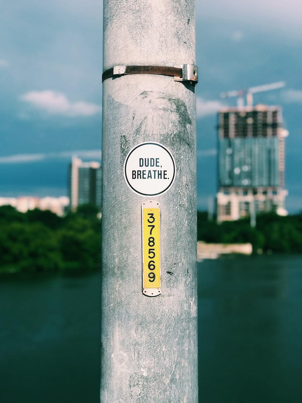 dude breathe sticker on gray post