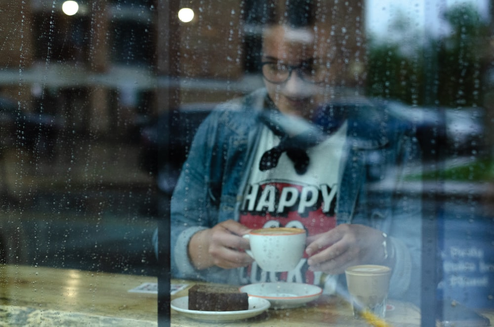woman having coffee inside coffee shop