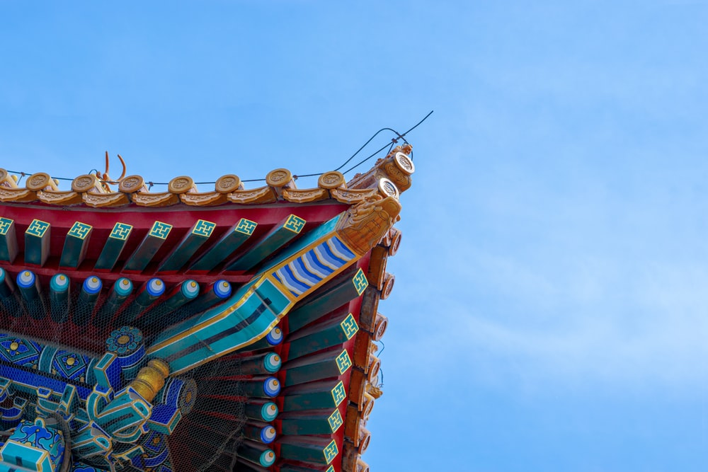 low-angle photography of temple