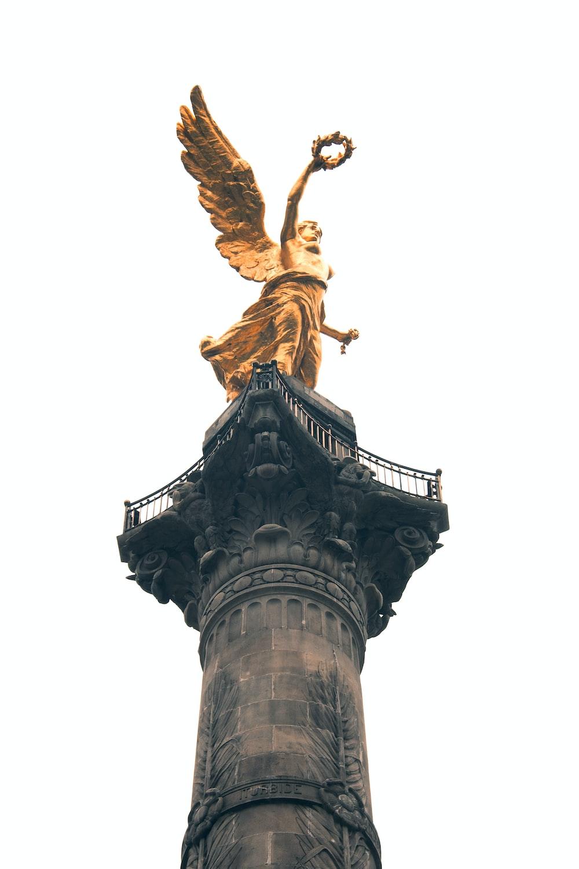 brass-color statue