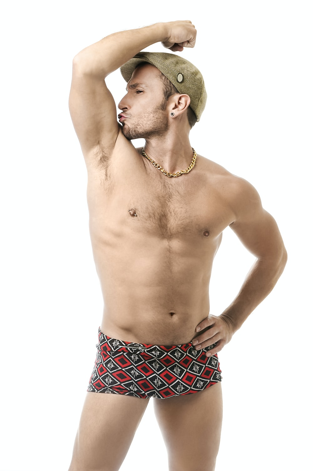 man wearing flat cap and boxer briefs