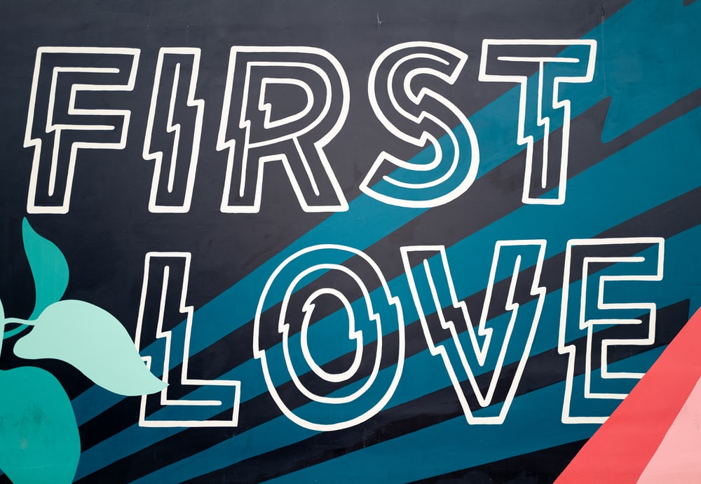 first love text on blue background