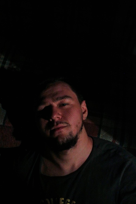 man in black crew-neck top