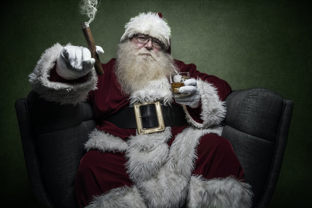 man wearing Santa Claus costume sitting on chair