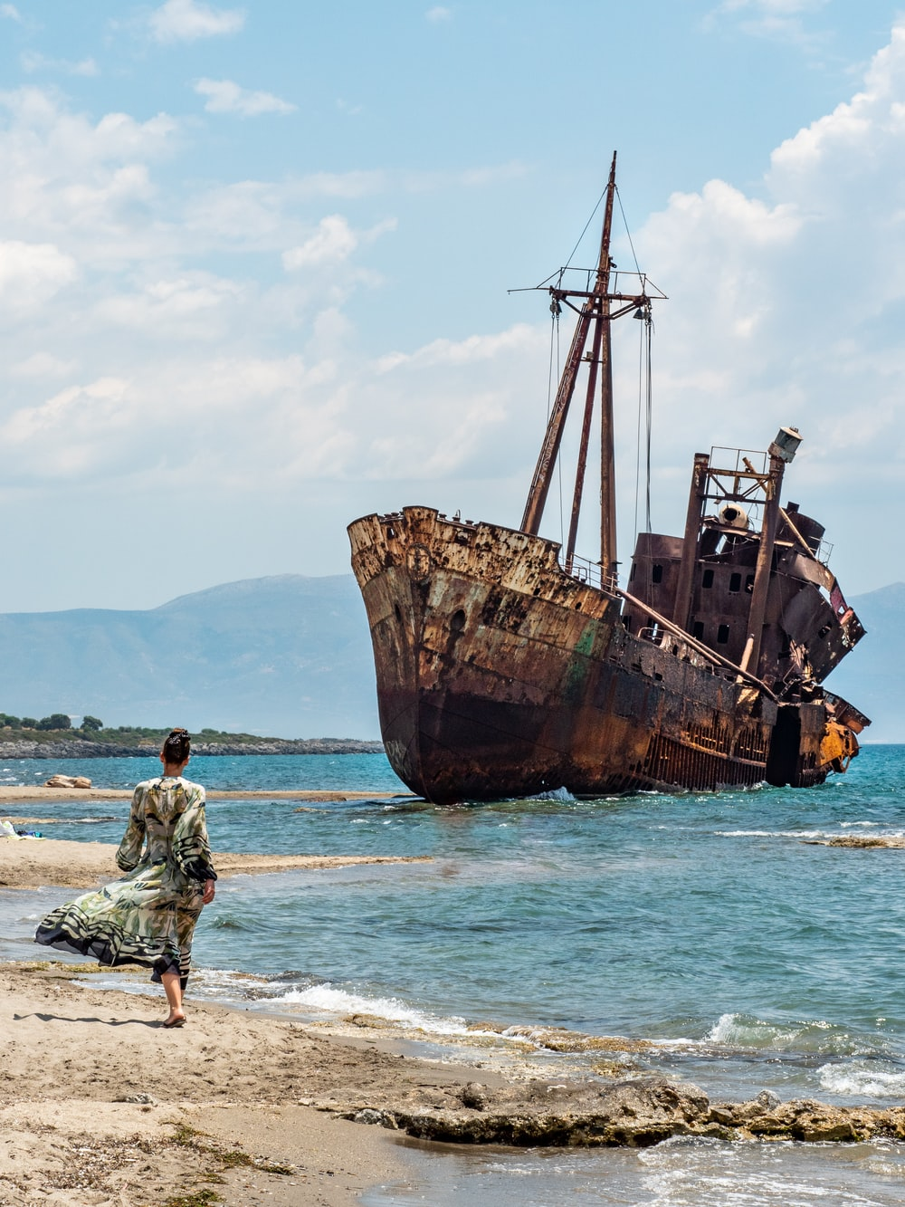 brown ship on shore