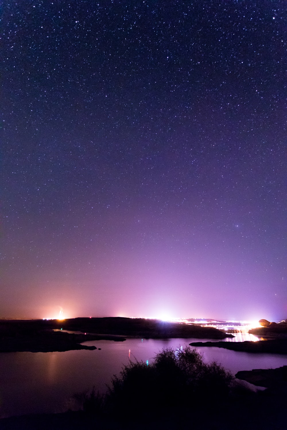 silhouette photography of islands under starry sky during nighttime