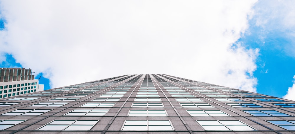 worms-eye-view photography of white city buildings