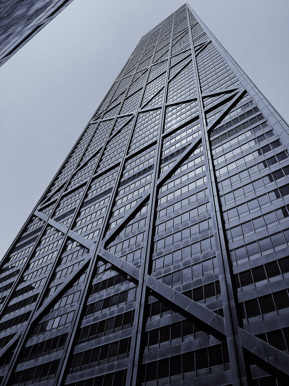 low-angle photo of glass building