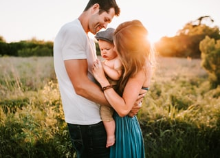 family photo on green grass during golden hour