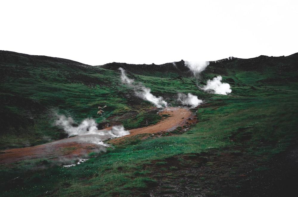 green grass with smoke