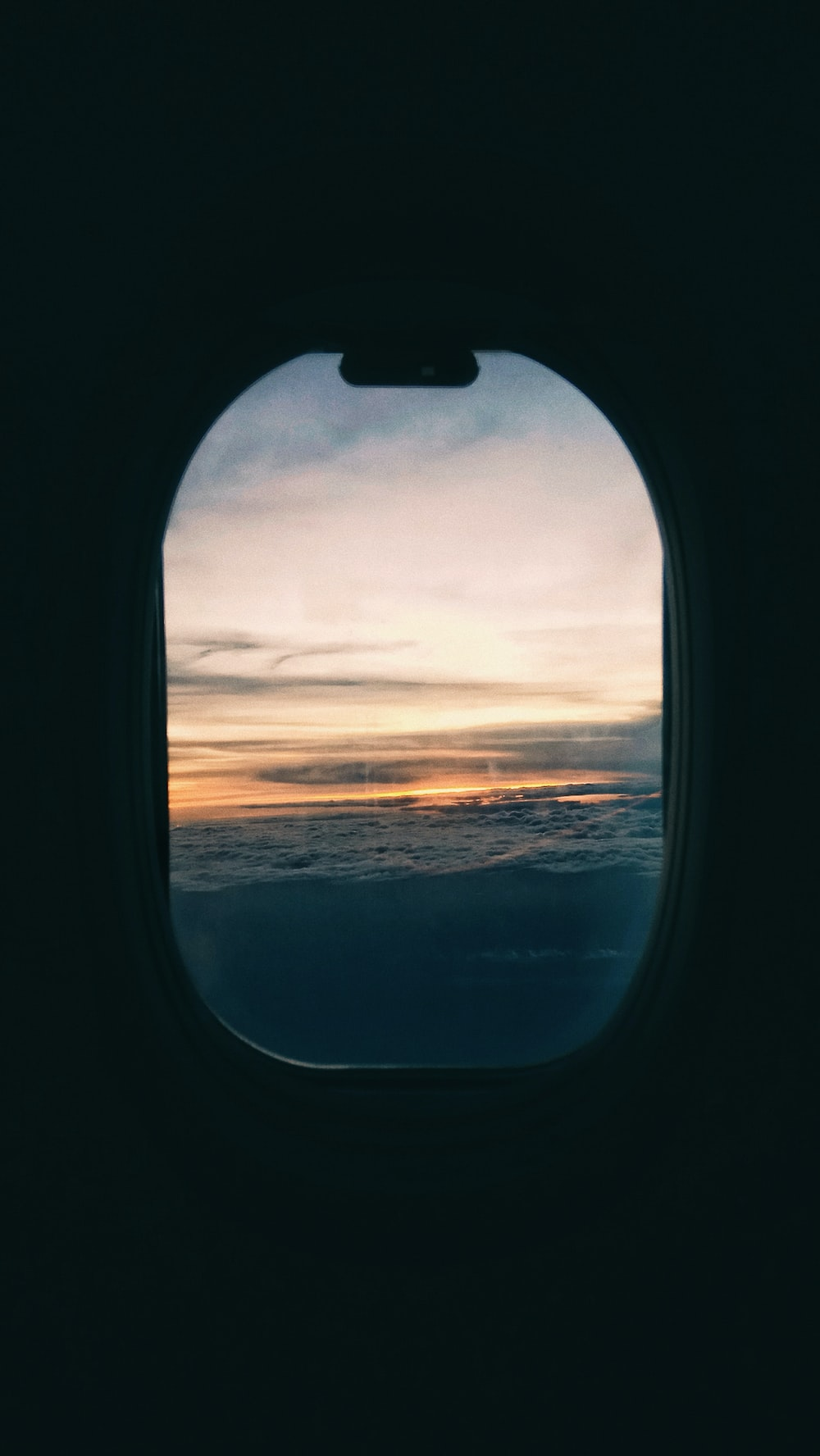 glass airplane window during golden hour