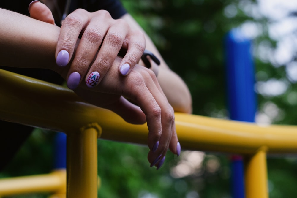 person with white manicure