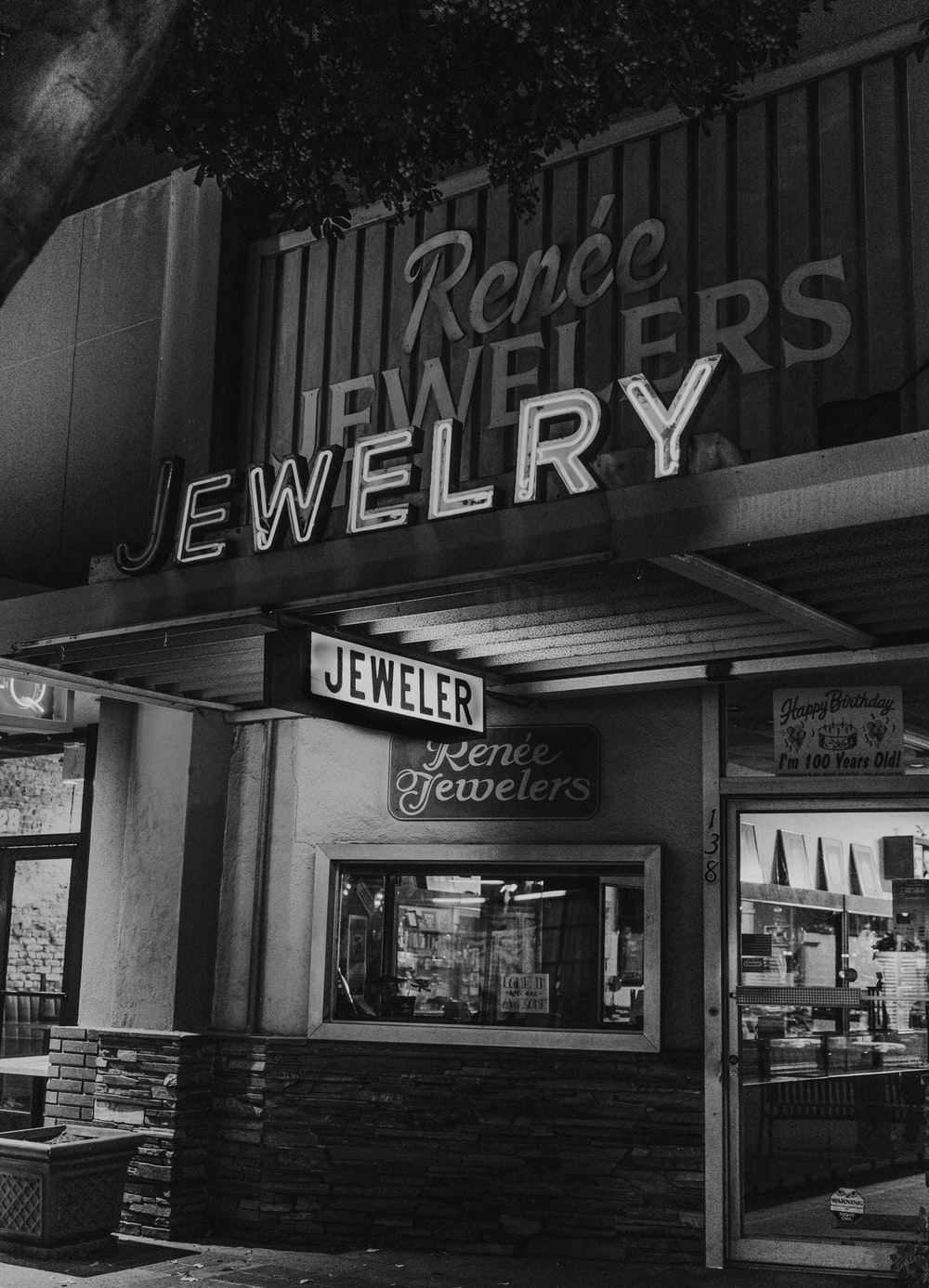 grayscale photo of Renee Jewelers