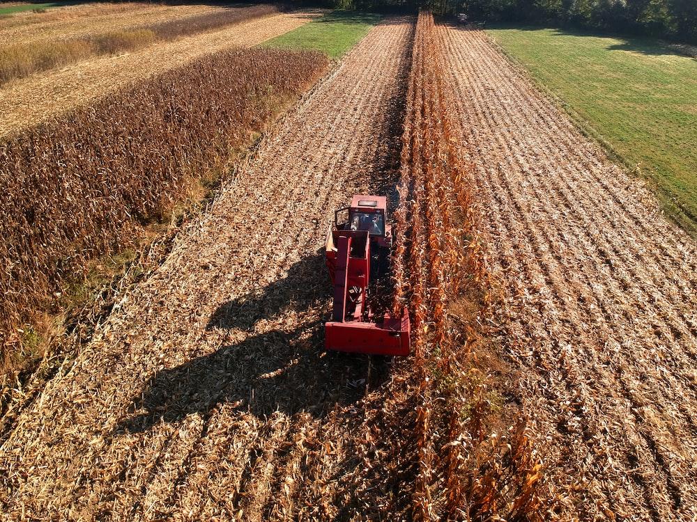 brown farm equipment at daytime