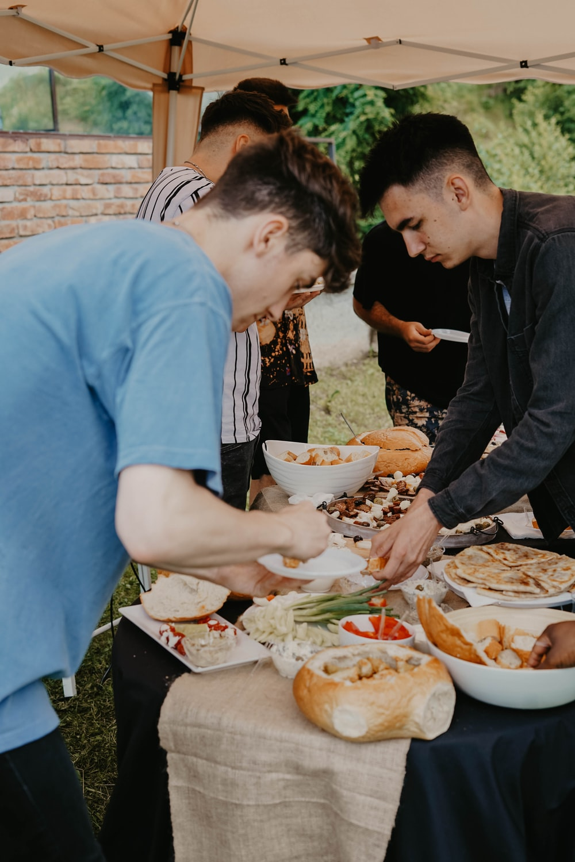 two men grabbing food