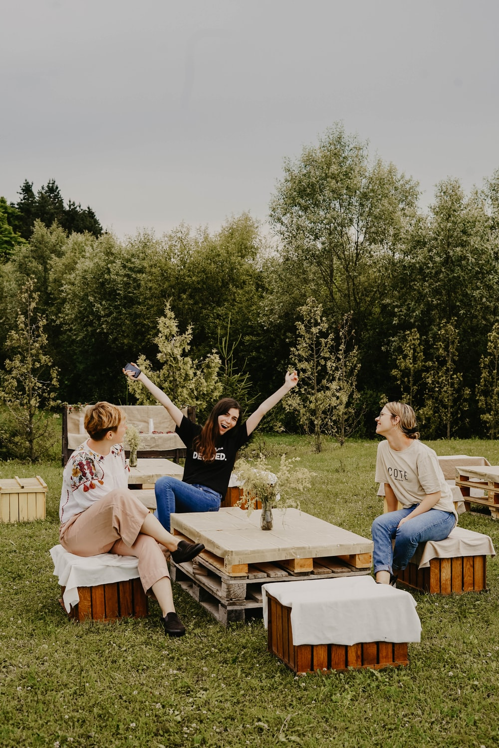 women sitting on chairs outdoor