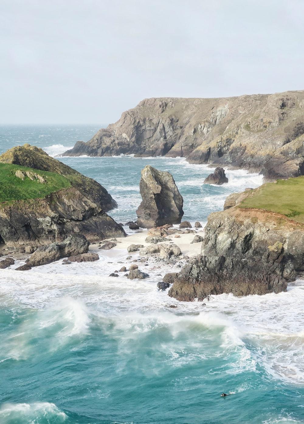 green and gray rocks near seaside