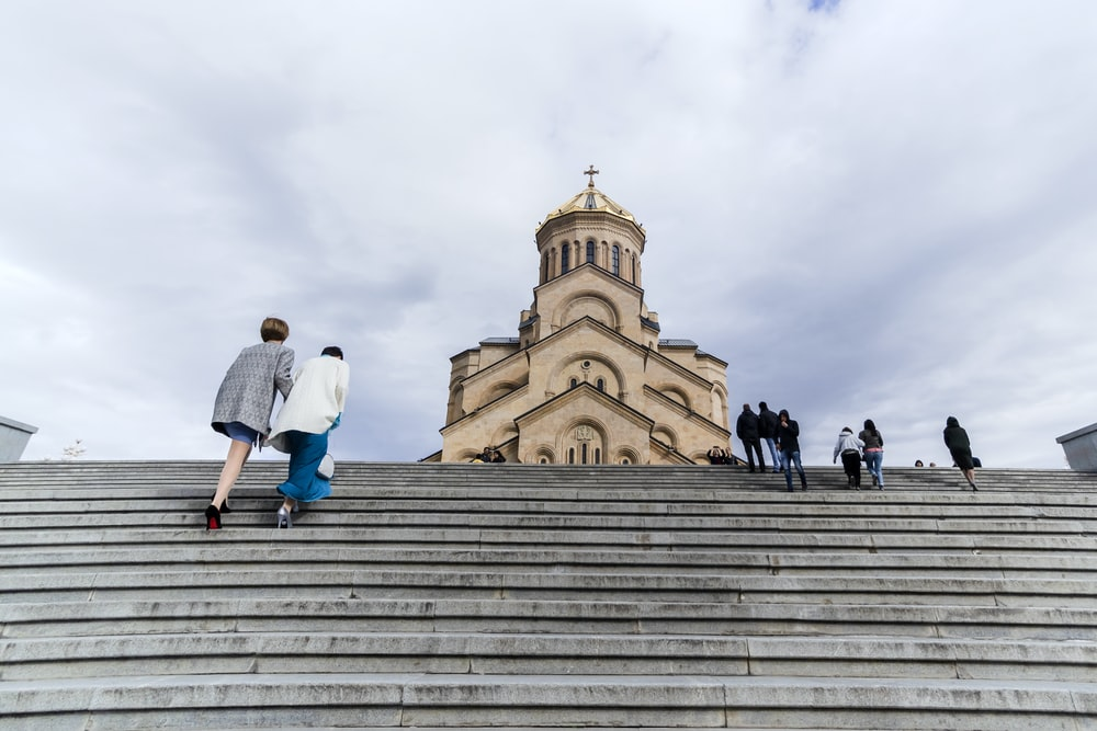 people walking near church
