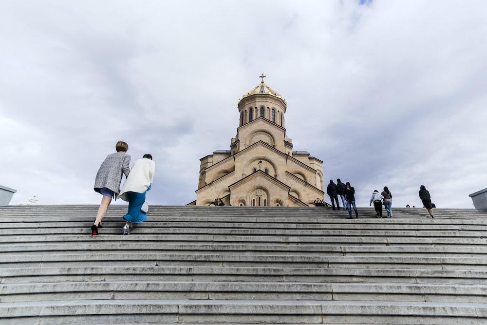 people walking near church