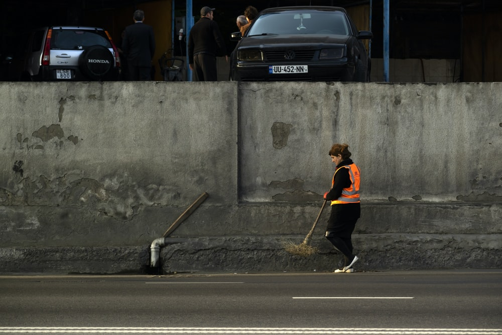 woman cleans the street