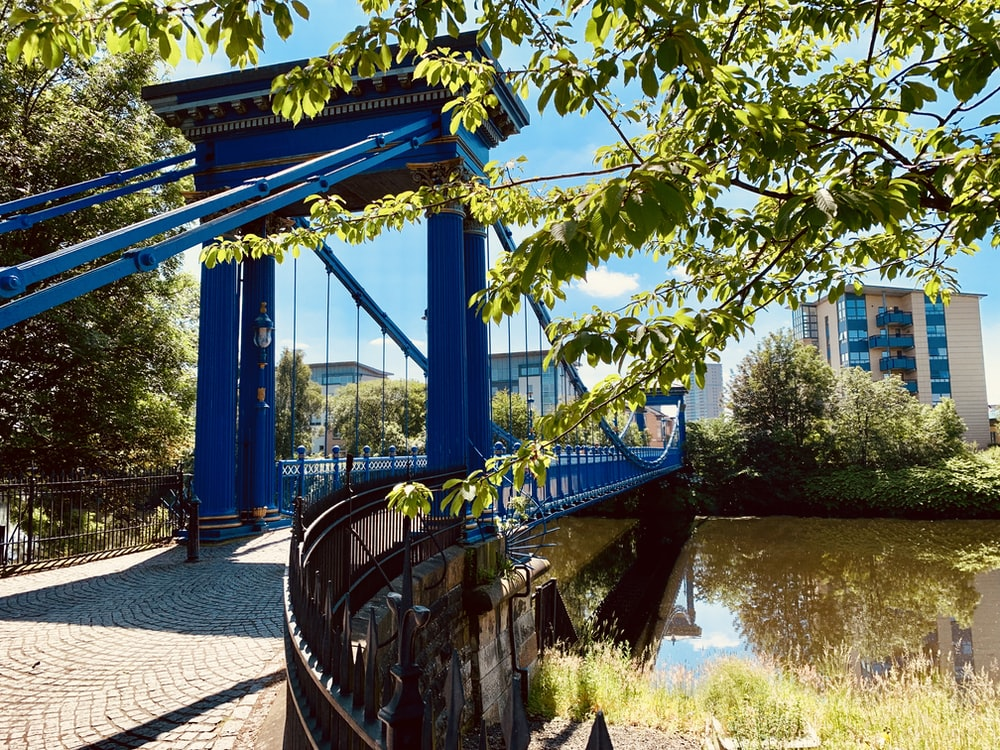 blue bridge across river