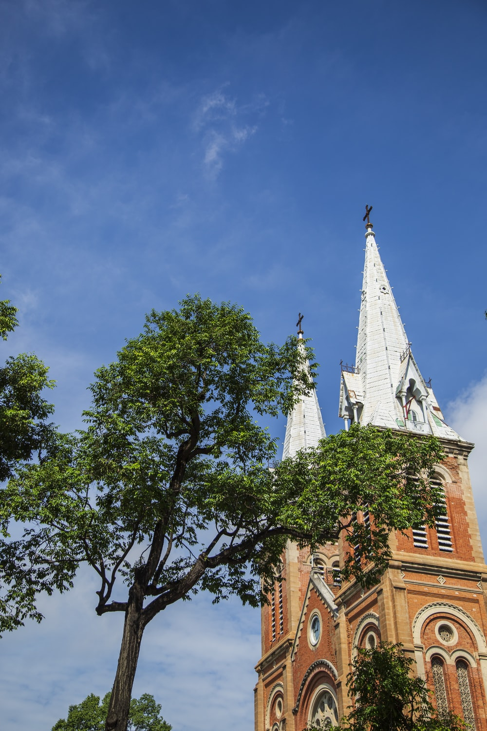 white and brown church steeples