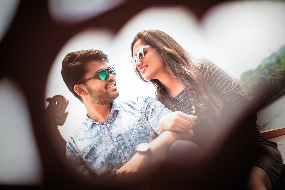 smiling man and woman sitting together