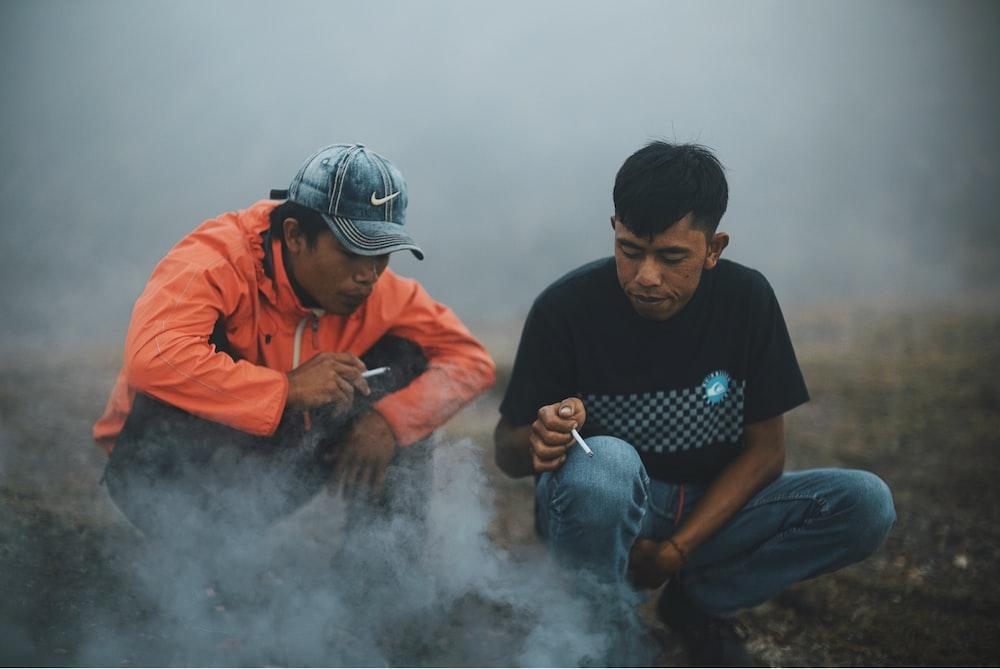two men near smoke