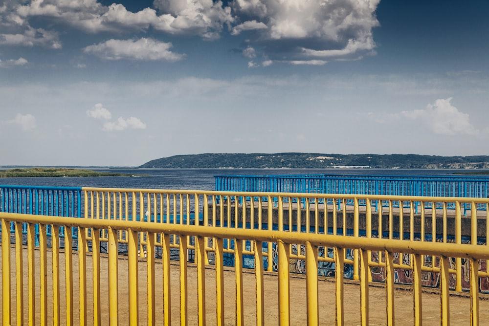 yellow metal railings at the dock during daytime