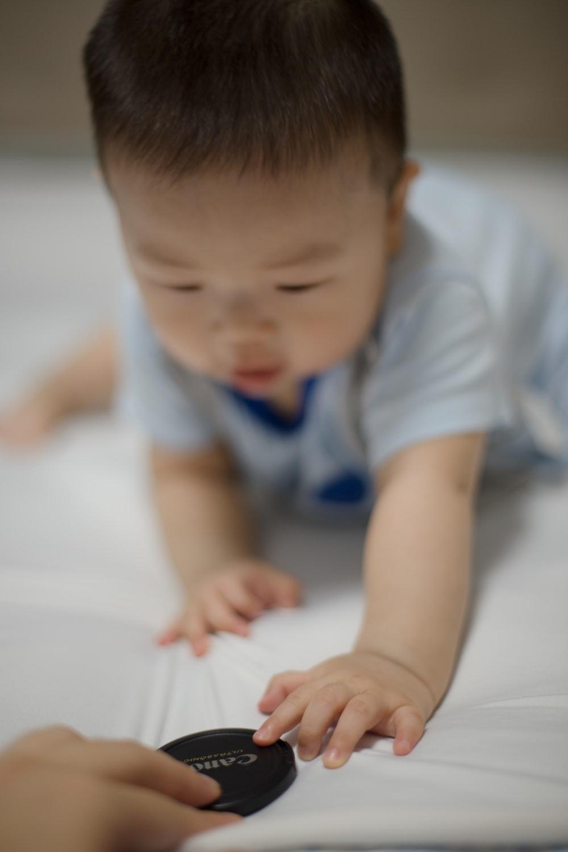 toddler in blue shirt