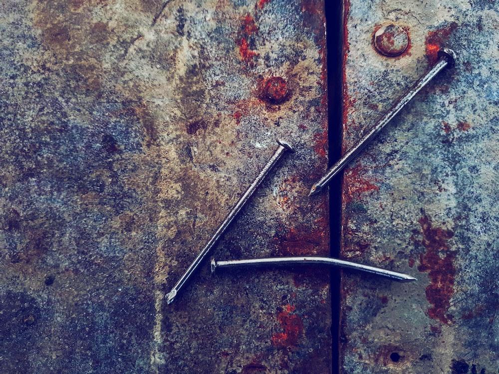 three grey metal nails