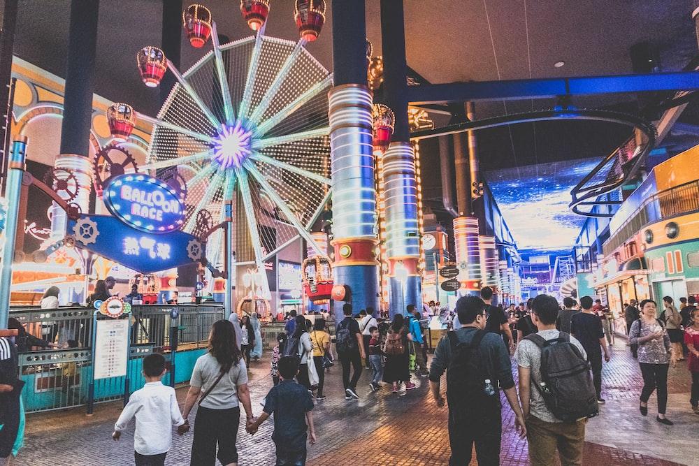 people walking near carnival ride