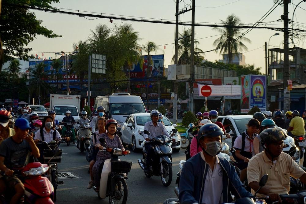 people riding vehicles during daytime