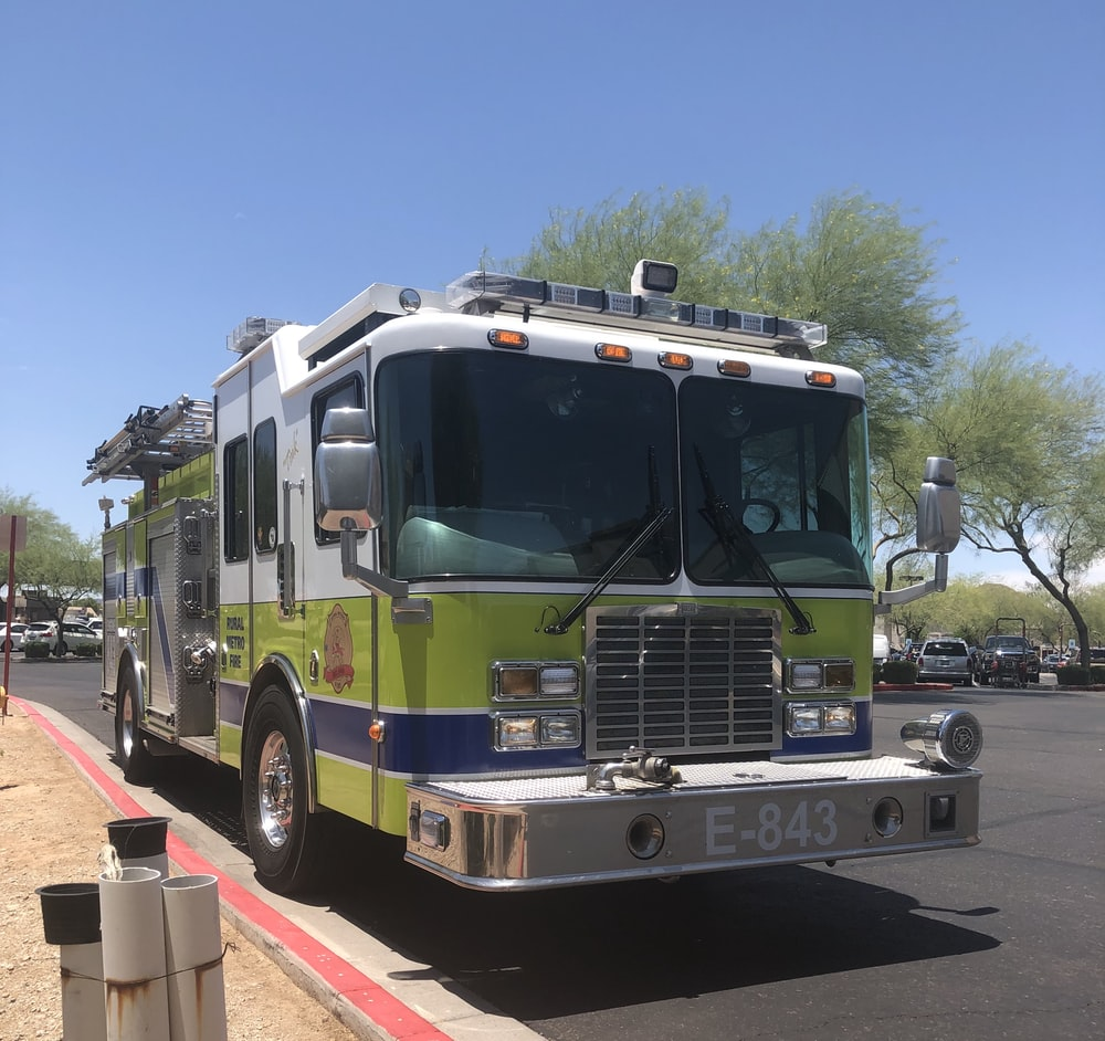 white and green firetruck with E-843 plate