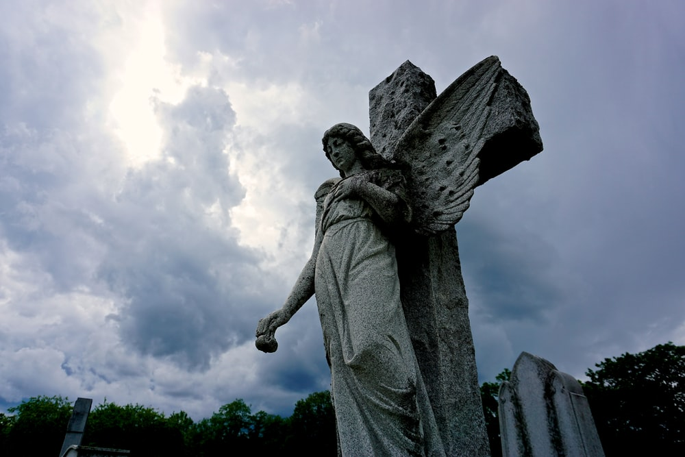 angel statue during daytime