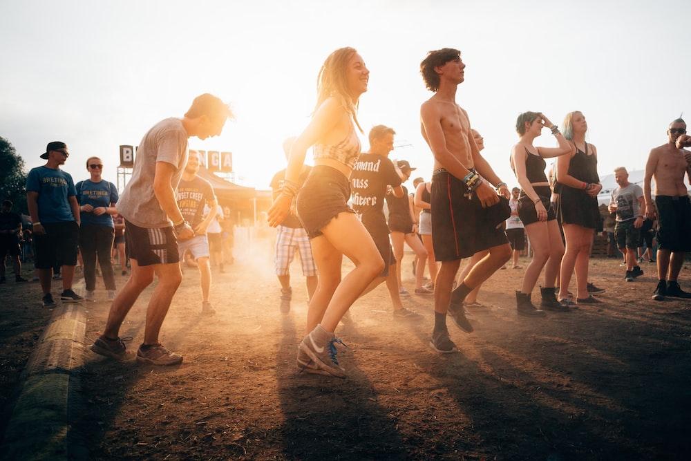 people dancing during sunset