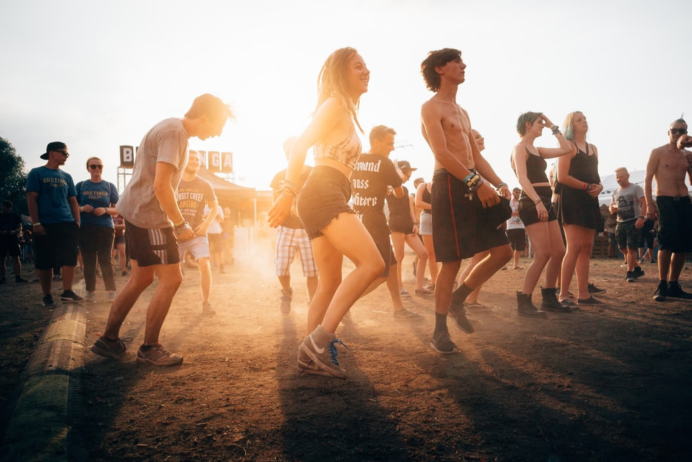 people dancing during sunset