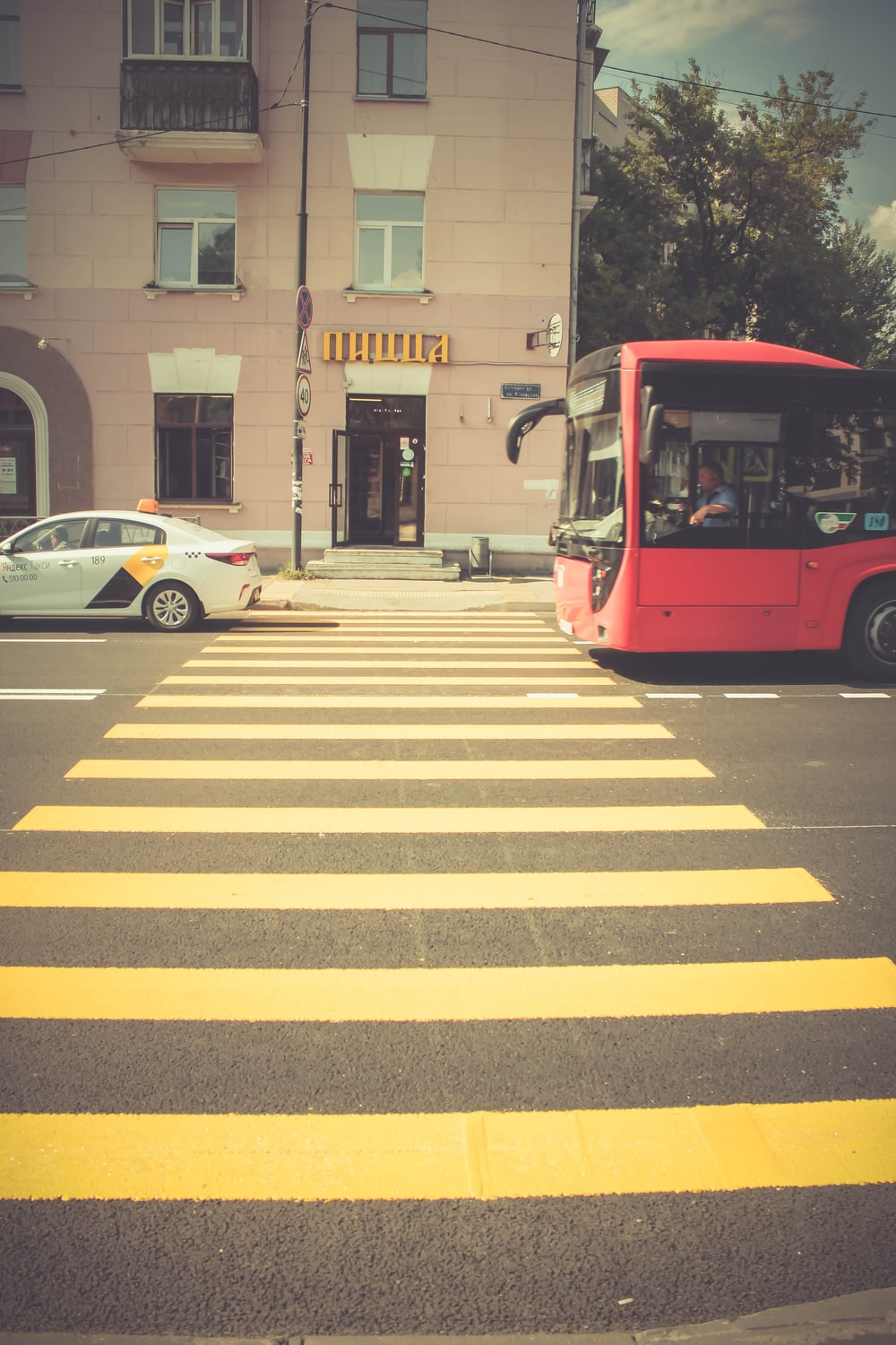 red bus near pedestrian lane