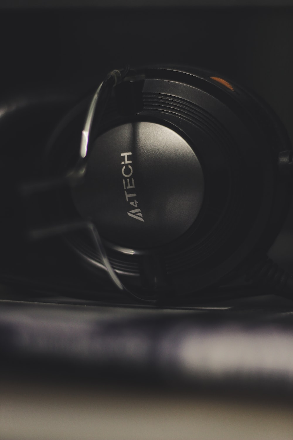 black and gray A4Tech headset