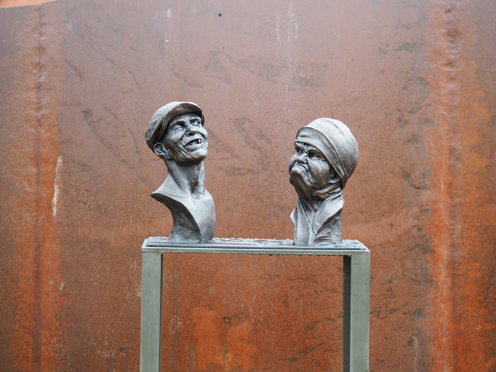 two black head bust figures