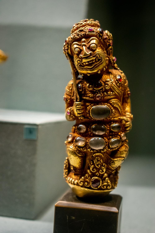 gemstone encrusted gold figurine