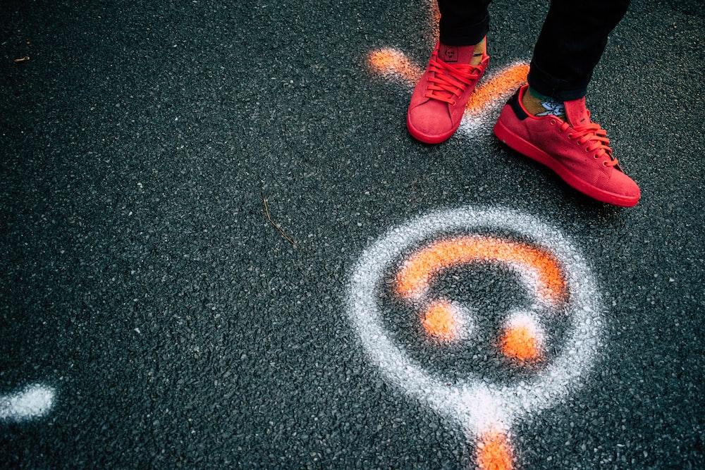 pair of red low-top sneakers
