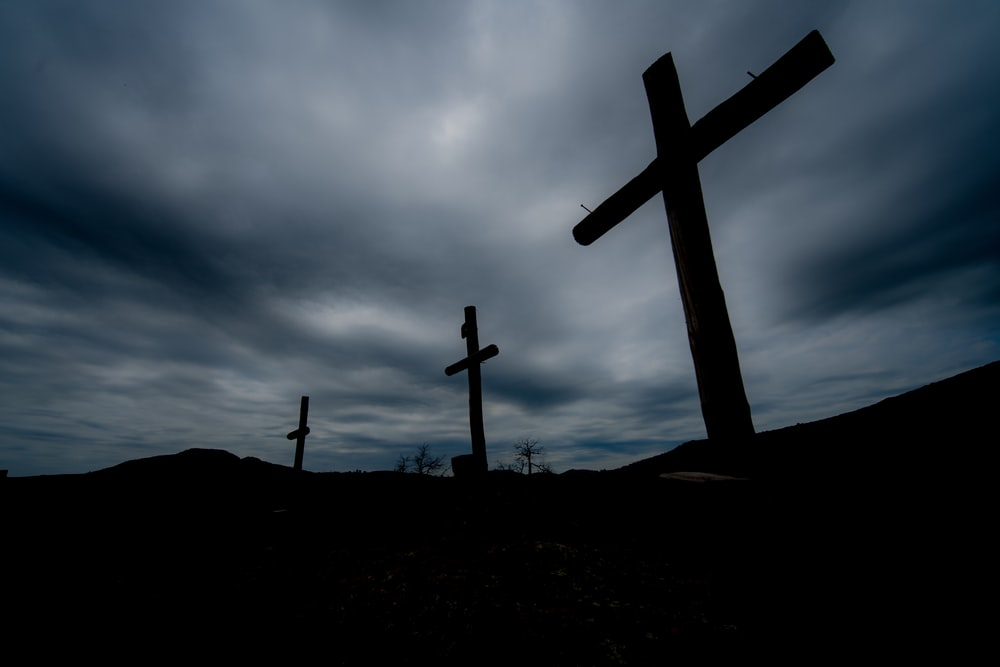 silhouette of cross during nighttime