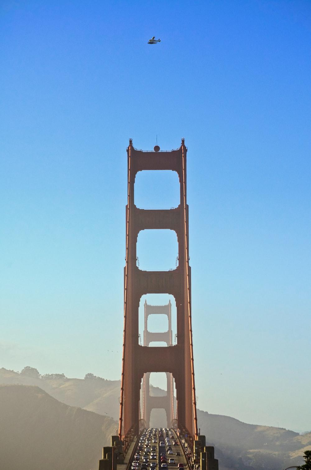 brown bridge under blue sky during daytime