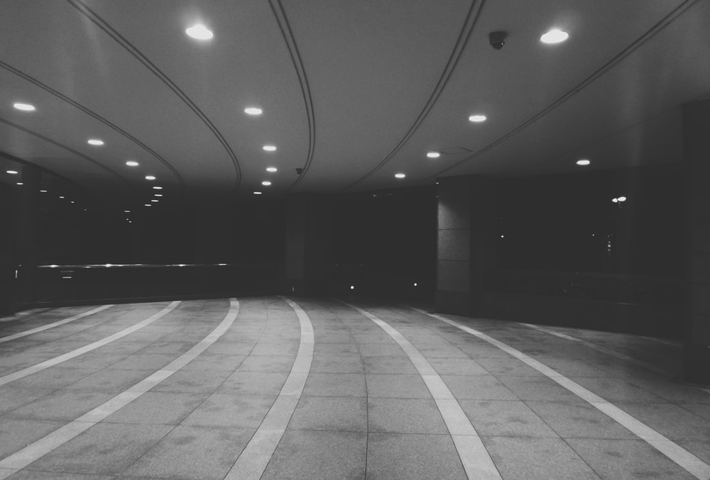 grayscale photography of road tunnel